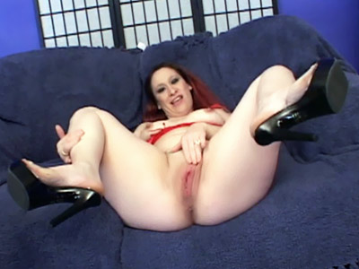 Sunshine shows us her swollen breasts and spreading her thighs for a black cock