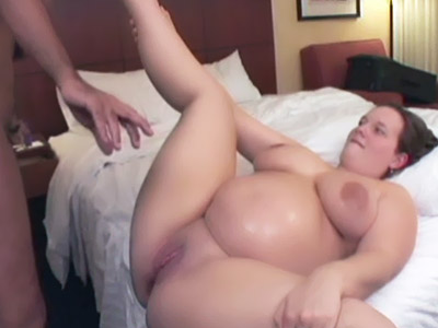 Chunky pregnant Tessa spread legged in bed while a cock goes in and out of her coot